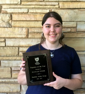 Hannah Onder holding the Rambler Media Group's Reporter of the Year Award for 2016-17. Photo by Paola Estrada