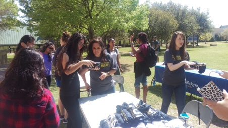 Alumni relations coordinator Christian Garcia checks TAG Day selfies at the booth on Thursday