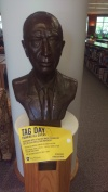 A statue in the Eunice and James L. West Library that has a yellow tag placed on it for TAG Day, which signifies that it is a result of alumni donations. Photo by Hannah Onder