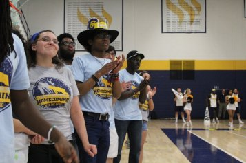 Sophomore music major Dexter Collins claps for the men's basketball team. Photo by Hannah Onder