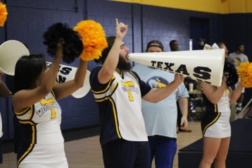 Sophomore criminal justice major Zach Lanham cheers during the women's homecoming basketball game. Photo by Hannah Onder