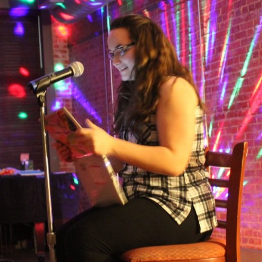 Senior English major Kime Sims performs an original poem at the Naked But Real open mike event on Thursday. Photo by Hannah Onder