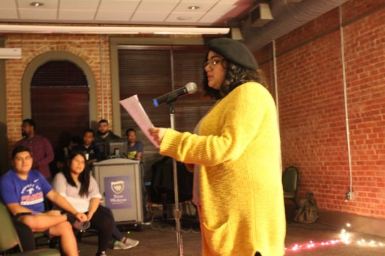 Sophomore Yonatzin Cardoso performs an original poem at Naked But Real. Photo by Hannah Onder