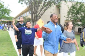 Students walk back from presentations to enjoy Ram Jam fun at University College Day. Photo by Hannah Onder