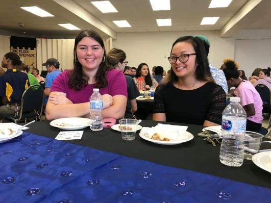 Hannah Onder and Tina Huynh sit together at the fall 2017 dean's list reception.