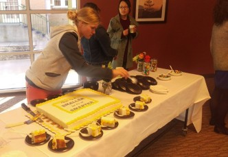 Heather Birge sets up refreshments at Darren White's goodbye party. Photo by Hannah Onder