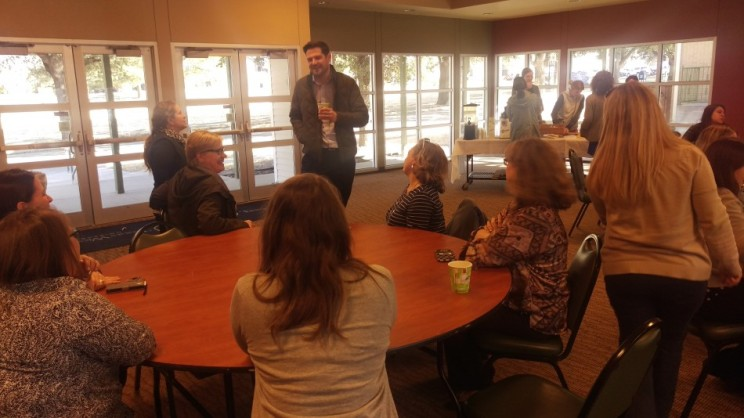 Darren White talks with attendees at goodbye party. Photo by Hannah Onder
