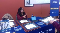 Zurra Hemani from Alumni Relations talks to seniors about diploma frames and donations. Photo by Hannah Onder