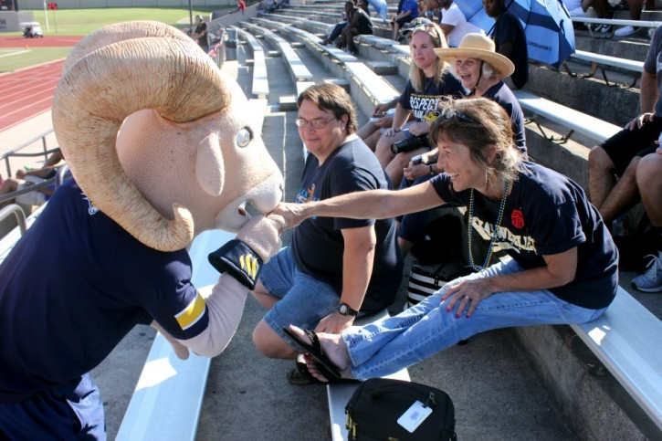 Willie the Ram kisses alumnus Karla Fry Hinkle's hand during the third quarter. Photo by Hannah Onder