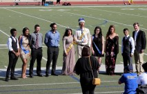 The homecoming court poses for a picture at the end of half time. Photo by Hannah Onder