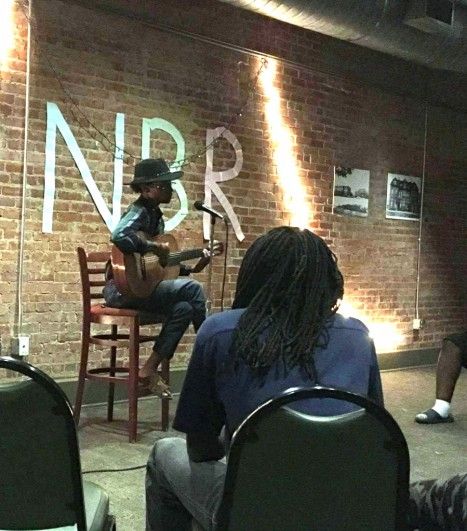 """Dexter Collins performs his original song """"Drowning"""" at Naked But Real. Collins performed twice at the open mic night. Photo by Hannah Onder"""