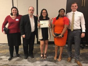 Hannah Onder, Dr. David Ferman, Tina Huynh, Dr. Ngozi Akinro, and Peyton Pruddhome attend the Society of Professional Journalist dinner.