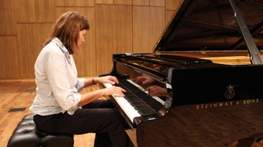 Dr. Ilka Araujo plays the Steinway piano in Nicholas Martin Hall. Photos by Tina Huynh
