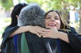 Senior mass communication Sarah Owens hugs Dr. Kay Colley, associate professor of mass communication, after robing. Photo by Hannah Onder