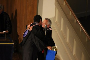 Senior music major Luis Calderon (left) hugs Dr. Jerome Bierschenk. Photo by Hannah Onder