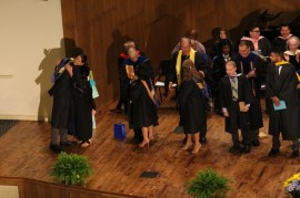 Seniors line up to exit to the left of the stage after their robing. Photo by Hannah Onder