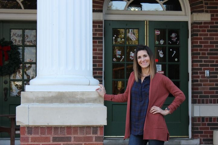 Robin Rivera poses outside of Dan Waggoner before class. Photo by Hannah Onder